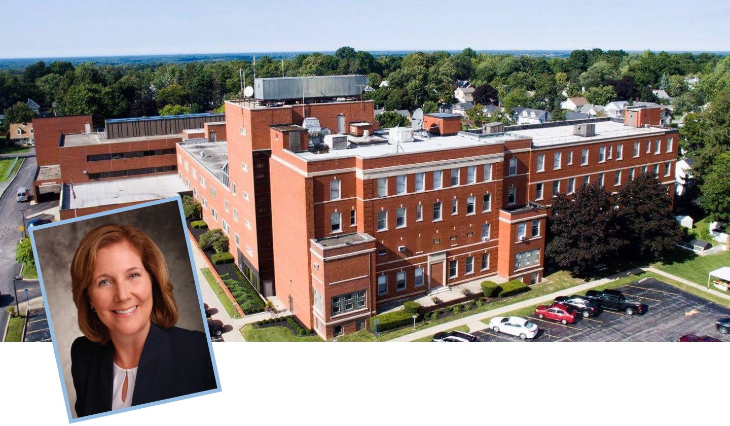 image of a photo of Eastern Niagara Hospital CEO Anne E. McCaffrey laid on top of, in the bottom left hand corner, a aerial photo of Eastern Niagara Hospital